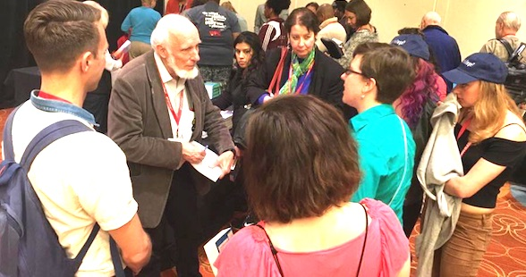 "James W Loewen, author of ""Lies My Teacher Told Me"" talks with attendees at White Privilege Conference 2016 in Philadelphia, Pennsylvania on April 16, 2016 (Facebook, White Privilege Conference)"