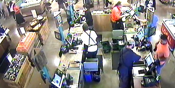 "Whole Foods security footage shows an employee scanning a bar code on the top of Jordan Brown's ""Love Wins"" cake. Brown claimed in a YouTube video that his cake came with a bar code attached to the side"