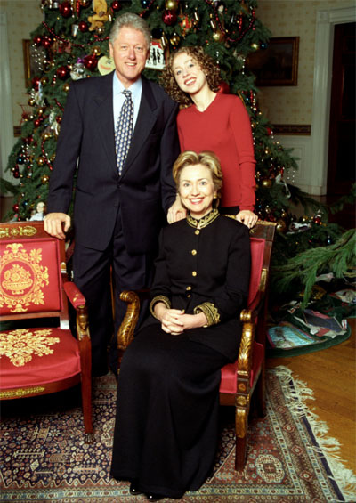 President Clinton, Hillary Rodham Clinton and Chelsea Clinton posing next to the 1999 White House Christmas tree for a family Christmas portrait (Photo: Clinton Presidential Library & Museum)