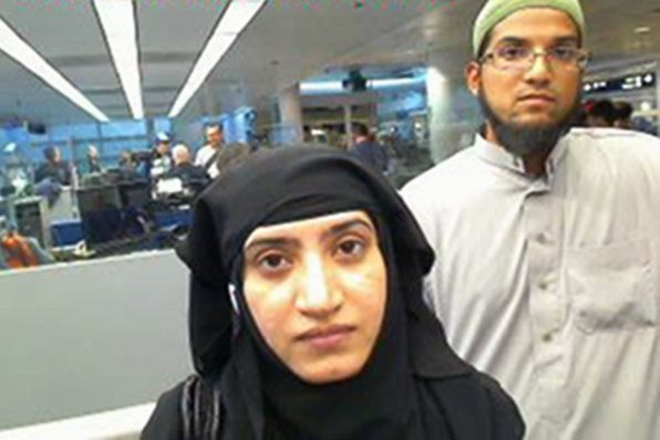San Bernardino killers Syed Farook and Tashfeen Malik in a security camera photo at Chicago's O'Hare Airport on July 27, 2014.