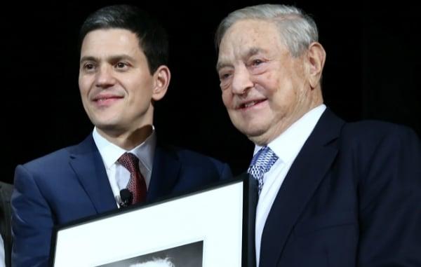 David Miliband, left, presents IRC Freedom Award to George Soros