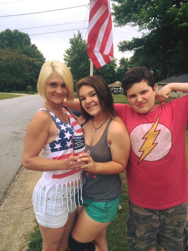 Dami Arno with her daughter Brittany, 17, and son Chuck, 14. The son held a gun on his mother and sister's Muslim attacker until police arrived.