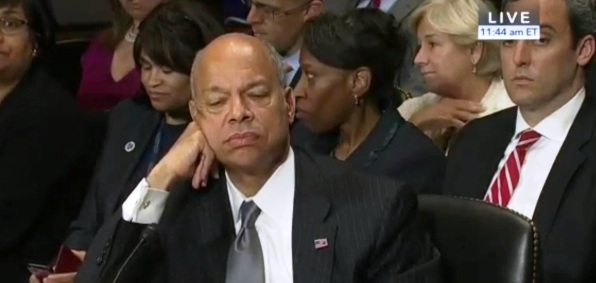 "DHS Secretary Jeh Johnson reacts to Sen. Ted Cruz, R-Texas, confronting him at a Senate hearing June 30, 2016, with testimony of former DHS officer Philip Haney that his agency ""purged"" records related to terrorism."