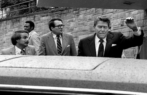 President Ronald Reagan being shoved into his limousine by Secret Service agents after being shot March 30, 1981.