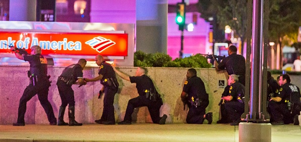 Dallas police officers respond to snipers