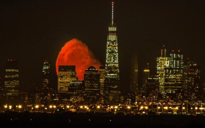 blood red moon seen over new york skyline