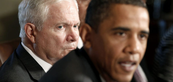 U.S. President Barack Obama speaks next to Secretary of Defense Robert Gates (L) in a cabinet meeting where President Obama commented on General McChrystal's complaints in a recent Rolling Stone magazine article, at the White House in Washington, June 22, 2010.     REUTERS/Larry Downing (UNITED STATES - Tags: POLITICS MILITARY) - RTR2FKF3