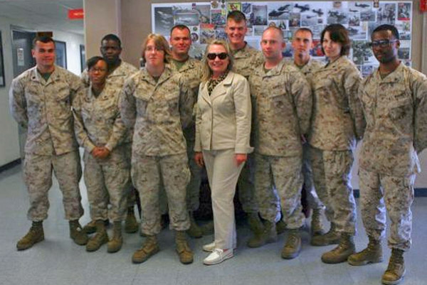 Then-Secretary of State Hillary Clinton poses for a group photo on Aug. 30, 2012, with U.S. Marines stationed at Marine Corps Air Station, Miramar, California (Photo: Cpl. Jamean Berry/Marine Corps)