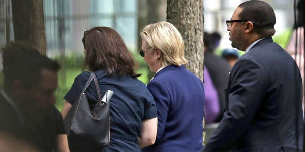 Hillary Clinton leaves 9/11 commemoration after appearing to faint from 'overheating'