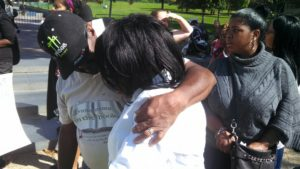 Valarie Carey is comforted at the third annual memorial in Washington, D.C., of her sister Miriam's death