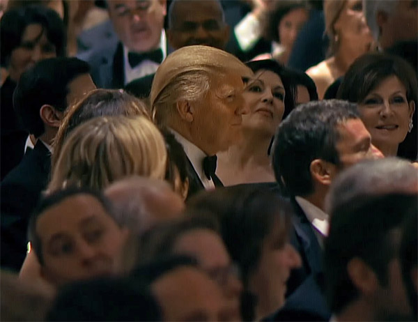 Donald Trump can be seen occasionally cracking a smile as everyone around him laughs at his expense (Photo: Screenshot)