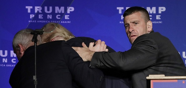 Donald Trump was rushed offstage by members of his Secret Service detail during a rally Nov. 5 in Reno, Nev., after a person in the crowd shouted that someone had a gun.