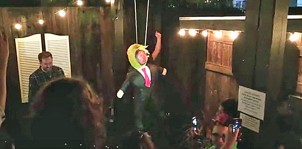 A pinata of Donald Trump gets whacked at an office Christmas Party in Portland, Oregon, in December 2016.