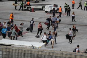 Passengers scramble during Ft. Lauderdale shooting on Jan. 6, 2017