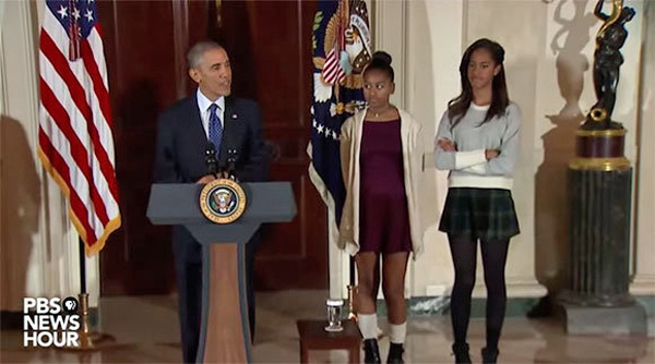 President Obama with daughters, Sasha and Malia, at 2014 Thanksgiving turkey pardoning ceremony (Photo: PBS)