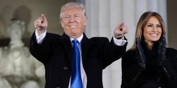 TRUMP Donald Trump pointing with Melania