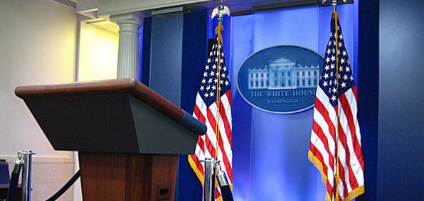 white-house-briefing-room-west-wing-media-flags-podium-600