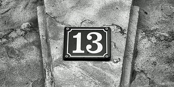 Street sign - House number 13 on sandstone wall friday the 13th