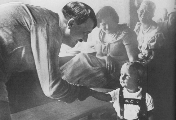 Hitler greeting a child