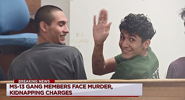 Miguel Alvarez-Flores (right) smiles and waves in Houston court as the gang leader known as 'Diabolico' and his partner 18-year-old Diego Hernandez-Rivera (left) faced charges of aggravated kidnapping and murder