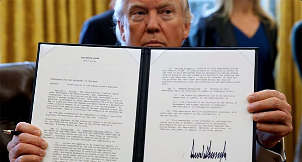 President Donald Trump issues an executive order (Photo: Twtter)