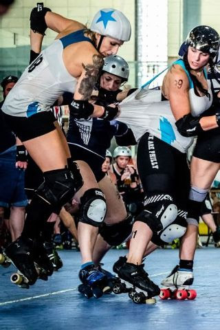 Transgender Vanessa Sites (left) skates in women's roller derby