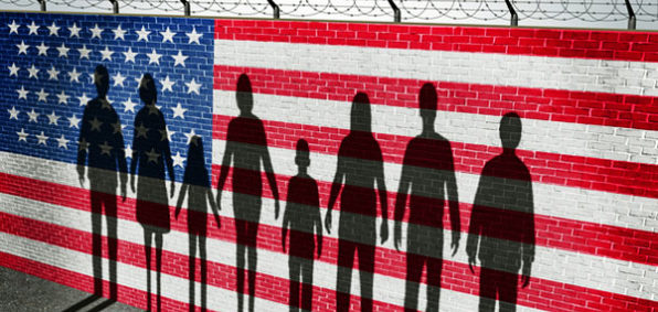 illegal-aliens-immigration-flag-border-wall-shadows