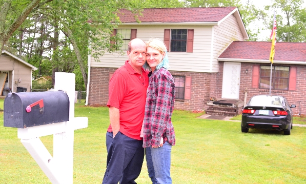 Dami and Jimmy Arno in front of their home in Lawrenceville, Georgia, April 24 2016, nearly one year after Dami was attacked by a complete stranger wearing a black burqa and beaten with the flagpole that was flying from their mailbox.