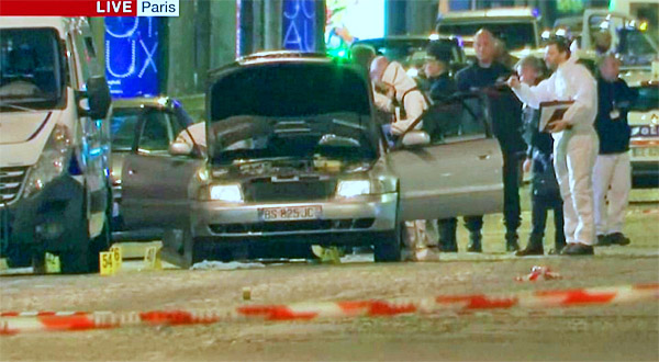 "French police search a vehicle near the scene where an alleged ISIS ""fighter"" opened fire on police in Paris on April 20"