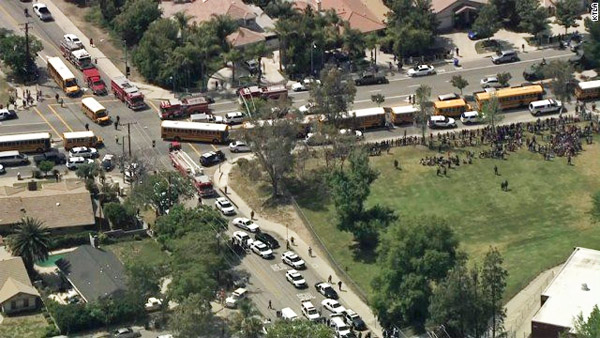 Buses evacuate students at a San Bernardino, California, elementary school where two adults were killed and two students injured April 10 by a shooter (Photo: Twitter/KTLA)