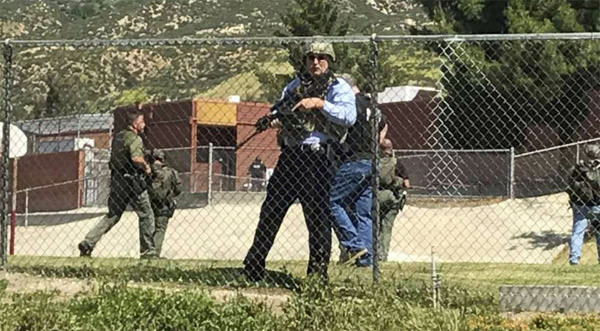 Police canvass parking lots at a San Bernardino, California, elementary school where two adults were killed and two students injured April 10 (Photo: Twitter)