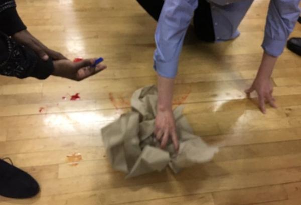 blood on floor minneapolis caucus meeting