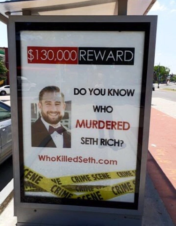 Jack Burkman's organization has posted signs and billboards asking, 'Do you know who murdered Seth Rich?' This one is located at a bus stop in the Columbia Heights section of Washington, D.C. (Photo: imgur)