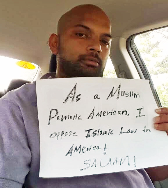A Muslim man named Mohamed who helped organize for 'March Against Shariah' holds a sign that reads: 'As a Muslim patriotic American, I oppse Islamic law in America! Salaam!' (Photo: Twitter)