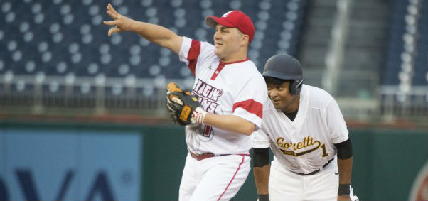 Rep. Steve Scalise, R-La., plays infield for the GOP squad during the 2016 Congressional Baseball game, with Rep. Cedric Richmond, D-La., on base.