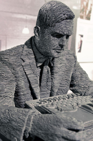 Statue of Alan Turing by Stephen Kettle at Bletchley Park – built from half a million pieces of Welsh slate (photo: Antoine Taveneaux CC BY-SA 3.0)