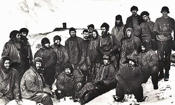 Hearty Antarctic explorers pose for a moment captured for all posterity
