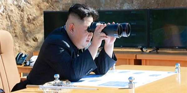 This sceenshot of a news bulletin aired by North Korea's KRT on July 4, 2017, shows what was said to be North Korea leader Kim Jung-un looking through binoculars to watch the launch of a Hwasong-14 intercontinental ballistic missile in North Korea's northwest