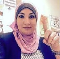 Linda Sarsour flashes the 'oneness of Allah' sign often seen by ISIS fighters