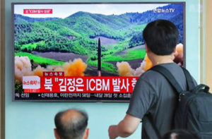 People at a Seoul train station watch a local TV news report on what the station claims is the launch of a Hwasong-14 intercontinental ballistic missile on July 4, 2017. North Korea claimed to have tested its first intercontinental ballistic missile in a launch Tuesday (Photo: KRT screenshot)