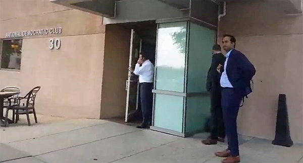 DNC staffers outside DNC headquarters on the anniversary of the murder of DNC staffer Seth Rich. Vigil attendees urged them to answer questions (Photo: Screenshot)