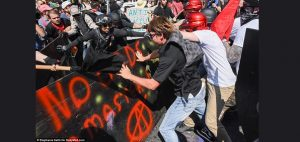 Far right protesters battle far left counter protesters Saturday in Charlottesville, VA.