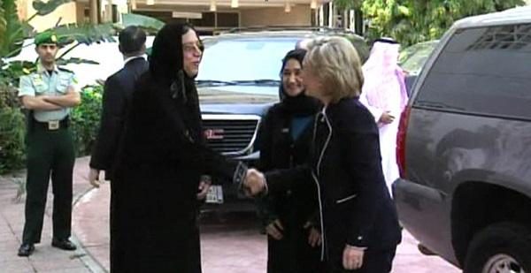 Saleha Abedin greeting former Secretary of State Hillary Clinton in Saudi Arabia