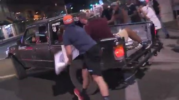 A supporter of President Trump, in the truck,. getting sucker-punched by an anti-Trump protester in Phoenix