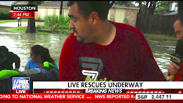 Pastor Carlos Pleitez rescues a family in Houston Aug. 29, 2017 (Fox News screen capture)