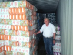 William Murray inspects containers of diapers in Iraq as part of a charity inspection tour.