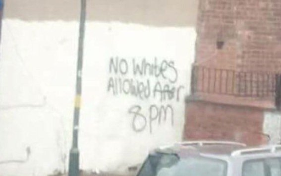 A racist graffiti sign that read 'No Whites Allowed After 8 pm' but has since had 'Whites' scribbled out in Alum Rock, Birmingham. The writing appeared recently in the largely Muslim inner-city neighborhood and circulated on social-media. Alum Rock is an 80% Muslim populated area. The area made headlines earlier this year when two men who lived there were found guilty of multiple terrorism offences. ... SEE COPY ... PIC BY NEWS DOG MEDIA ... 0121 517 0019