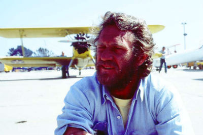 Steve McQueen and the biplane in which he learned to fly (Still from