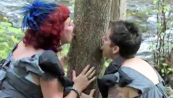 Elizabeth Stephens, art professor, 'eco-sex' expert and chairwoman of the art department at the University of California at Santa Cruz and her 'wife,' Annie Sprinkle getting 'dirty' and licking a tree (Photo: Screenshot)