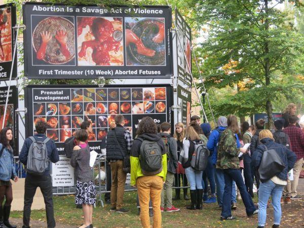 Crowd gathers at CBR anti-abortion display at PSU, Oct 16. Photo: Lincoln Brandenburg